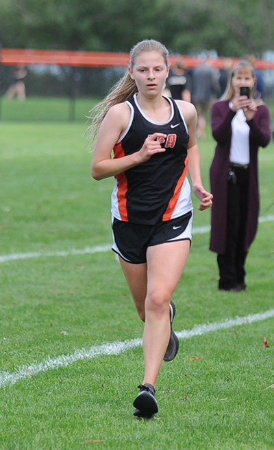 member of the girls cross country team near the finish line